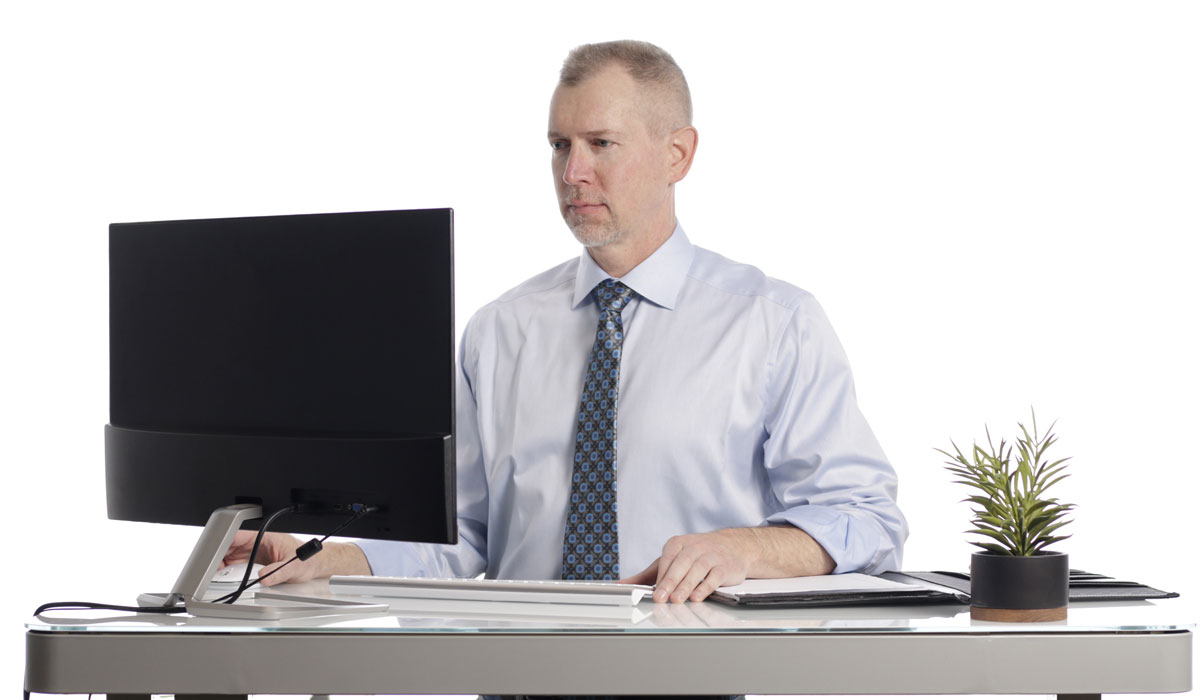 Todd Noonan Working at Desk